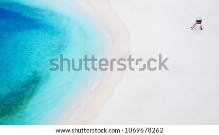 Lifeguard Station on beach and blue turqouise sea water from high angle in Naha, Okinawa, Japan #1069678262