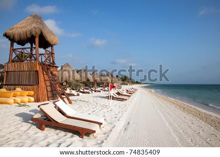 Lifeguard tower, beach umbrellas & beds on the Caribbean beach