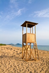 Lifeguard tower in the beach against blue sky in the afternoon