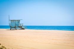 Lifeguard tower on an empty beach in Malibu, California