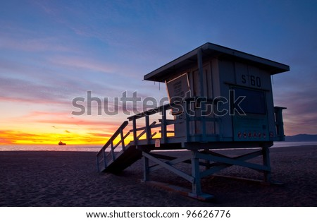 Lifeguard tower under a beautiful sunset - El Segundo Beach, Los Angeles, California.