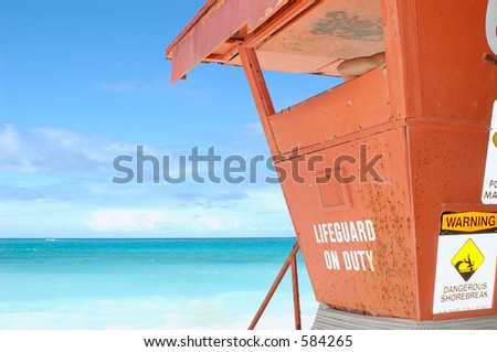Lifeguard tower with lifeguard's arm showing