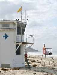 lifeguard watching over beach goers on a cloudy summer day