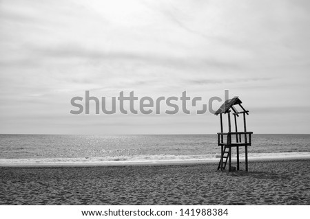 Lifeguard wooden beach observation tower, black and white