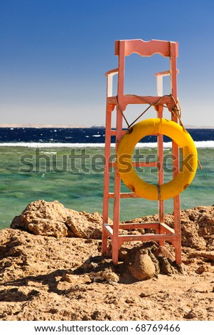 Lifeguards place with a life buoy - stock photo