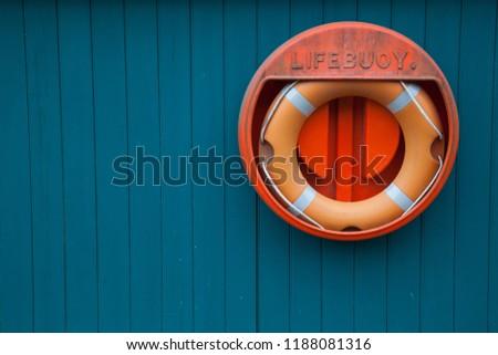 lifering on blue wall Stok fotoğraf ©