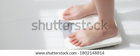 Lifestyle activity with leg of woman stand measuring weight scale for diet with barefoot, closeup foot of girl slim weight loss measure for food control, healthy care concept, banner website. Stock photo ©