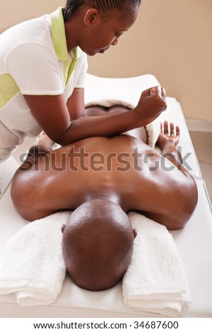 lifestyle, African American man having a massage treat at the spa, or injury chiropractor