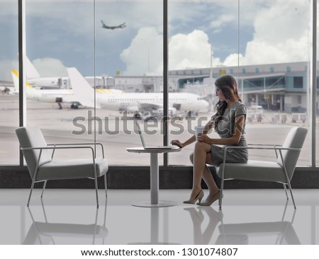 Lifestyle business woman, executive traveller working on laptop in airport terminal, with copy space #1301074807