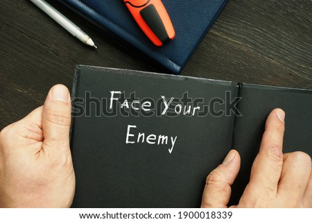 Lifestyle concept about Face Your Enemy with sign on the sheet. Stock photo ©