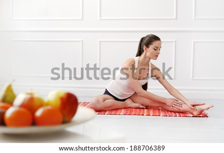 Lifestyle Cute attractive woman during yoga exercise
