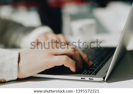 Lifestyle education student. Businessman work on laptop for project. Millennial at home office looking for job on notebook. Unrecognizable man using modern portable computer. #1395572321