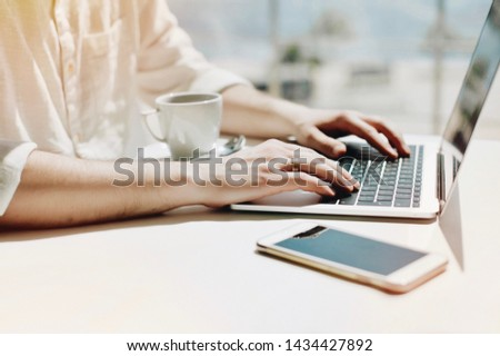 Lifestyle education student. Businessman work on laptop for project. Millennial at home office looking for job on notebook. Unrecognizable man using modern portable computer. #1434427892