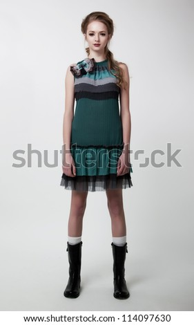Lifestyle. Fashion model lovely young female posing in contemporary dress. Series of photos