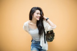 lifestyle fashion portrait of young stylish hipster Asia woman walking on street