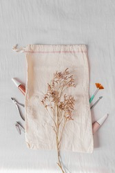 Lifestyle flat lay, top view, composition with nail polish, cotton bag and manicure tools. Beauty blog, manicure concept.