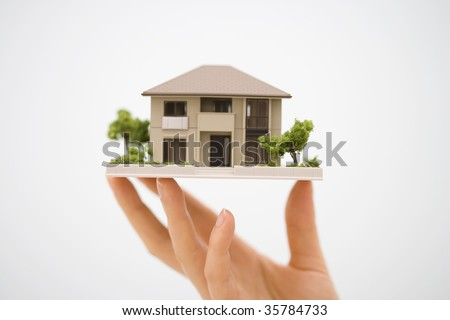 LIFESTYLE IMAGE-the model house with a woman's hand isolated on white
