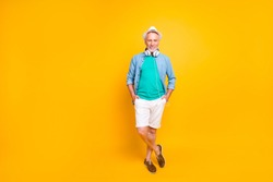 Lifestyle jeans denim clothes with bristle style concept. Full length size view photo portrait of wealthy excited carefree handsome cool gentleman standing with crossed feet isolated bright background