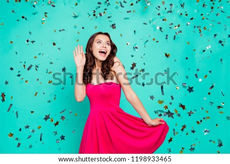 Lifestyle, leisure concept. Brunette laughter lady in pink short cocktail dress, modern curly hairdo look aside isolated on bright turquoise background screaming disbelief in the best day is coming
