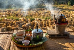 Lifestyle of Local Asian food In the rice field countryside Thailand.Blowing the fireplace for cooking in traditional kitchen in the morning. Hot chicken and rice soup, egg and herb tea