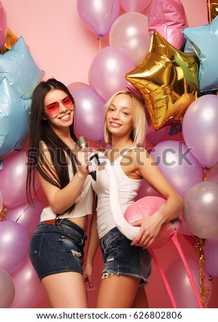 lifestyle, party  and people concept: Happy girls with microphon #626802806