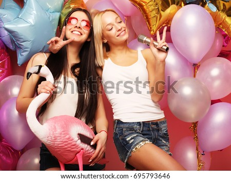 lifestyle, party  and people concept: Happy girls with microphon #695793646