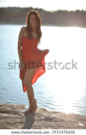 lifestyle photo of woman with perfect hair.walking alone at the beach.Sensual young girl relaxing.Colorful filter.glam style,teen trend outfit, positive mood,smiling,amazing model girl,long hair Foto stock ©