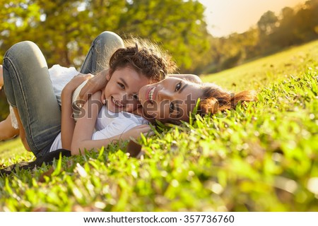 Shutterstock Lifestyle portrait mom and daughter in happines at the outside in the meadow