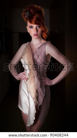 Lifestyle - red hair fashion model girl posing in contemporary dress - series of photos