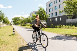 lifestyle, transport and people concept - young man or teenage student boy with backpack riding bicycle on city street