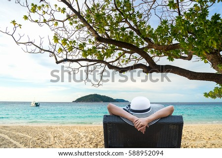 Lifestyle Young woman relaxing and happy on the summer beautiful luxury beach.  Summer and Lifestyle Concept #588952094