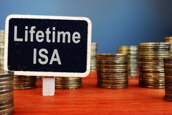 Lifetime ISA Individual Savings Account sign and coins.