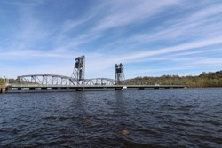Lift bridge connecting Minnesota and Wisconsin on the St Croix River.  Barge traffic is a regularity, as is fishing for bass and boating on the scenic byways.