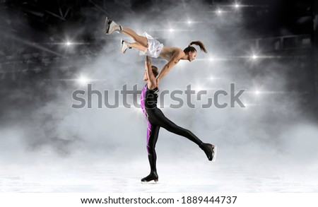 Lift. Duo figure skating in action on arena background. Sports banner