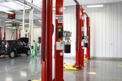 Lift mechanic uses to elevate cars for service work