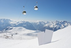 Lift pass card in snow with blurred ski-lift and mountain range. Concept to illustrate winter sport admission fee