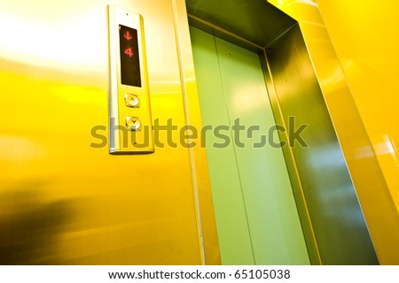 lift with buttons in a modern business building. - stock photo
