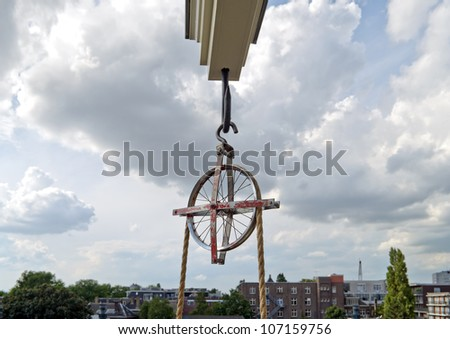 Lifting beam and wheel for moving furniture into or out of a tall house in Amsterdam.