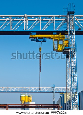 Lifting crane at industrial harbor site