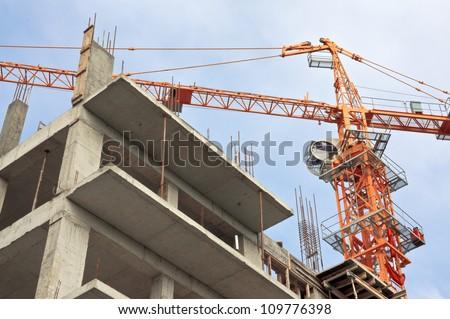 Lifting crane on a background sky