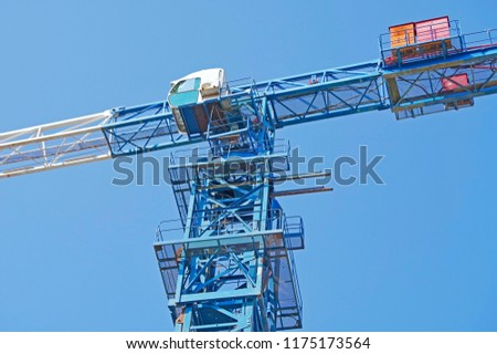 Photo of Lifting faucet on a background blue sky