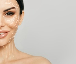 Lifting skin. Lifting lines on half of a woman's face, advertising of face contour correction, skin and neck lifting. Facial rejuvenation concept