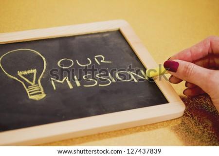 lighbulb and business mission chalk design on blackboard