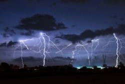 Lighning bolt over night sky in central europe