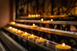 Light a candle for someone. Candles are lit for prayer intentions in the cathedra or basilica