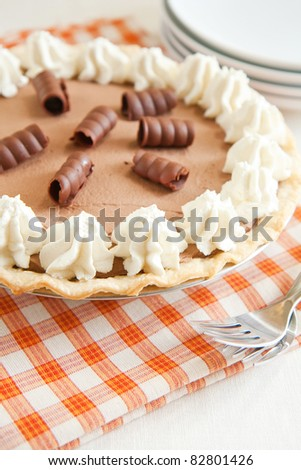 Light and chocolatey French Silk Pie with plenty of whipped cream and chocolate curls