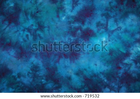 Light and dark blue tie dyed fabric