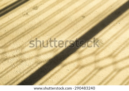 light and shadow by fence