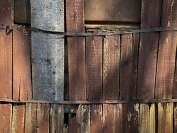Light and shadow on an old wooden fence as texture or background