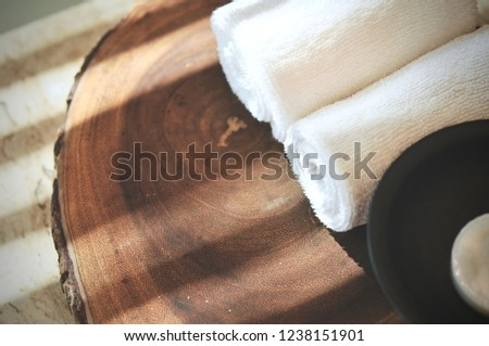 Light and shadow on the granite floor and Warm atmosphere in spa resort, Close up of spa essentials and towels on wooden tray in bathroom, essential oil. Spa products set conception. #1238151901